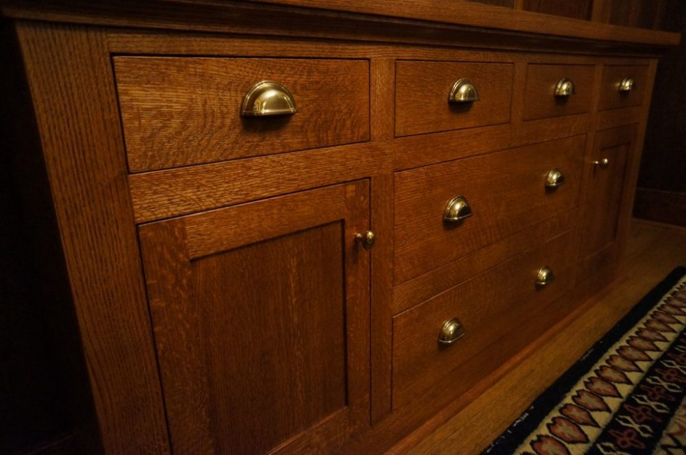 Craftsman style custom cabinets featuring inset doors, solid brass pulls, and quarter sawn oak