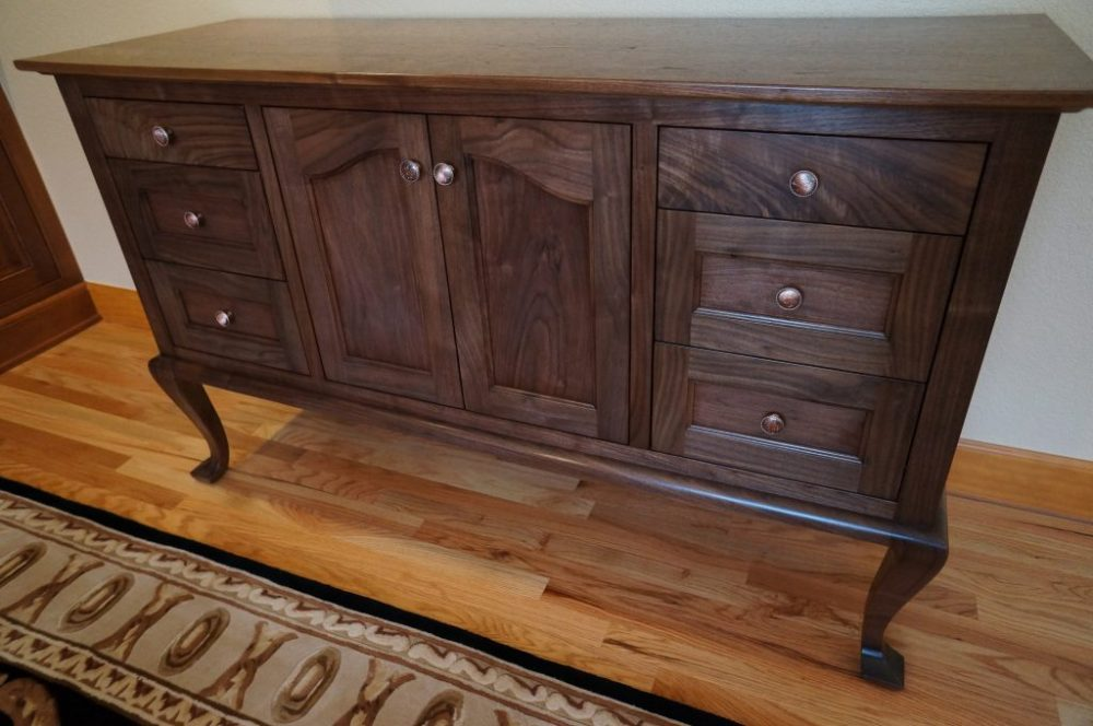 Queen Ann inspired sideboard made with walnut and copper pulls