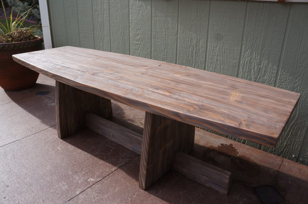 George Nakashima style coffee table / Bench featuring a natural gray barnwood finish.